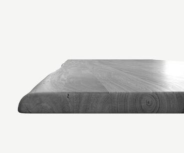 Edge Esstisch mit einer Baumstammkante