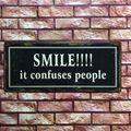 Wandschild SMILE!!!! It confuses people - Blechschild im Vintage Look  – Bild 2