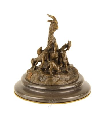 Goat mother with her children in the mountains as bronze statue  – image 2