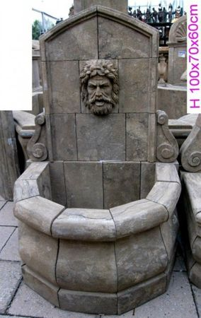 Antique wall basin stone fountain with motive in man's head decoration for garden terrace