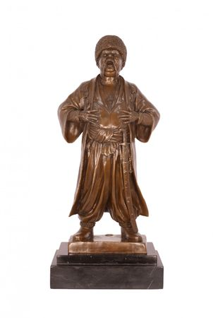 Bronze Statue Cossack on roaring with sword in his belt standing on marble
