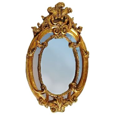 Vintage look oval wall mirror in baroque style in gold color as decoration