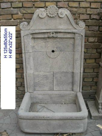 Flower motif stone basin wall with fountain and sink for decoration of garden or terrace