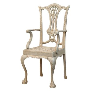 Antique garden metal chair in white as conservatory decoration – image 1