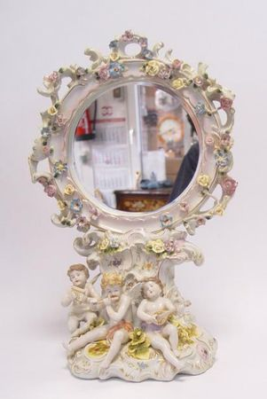 Baroque style porcelain mirror with angel childern