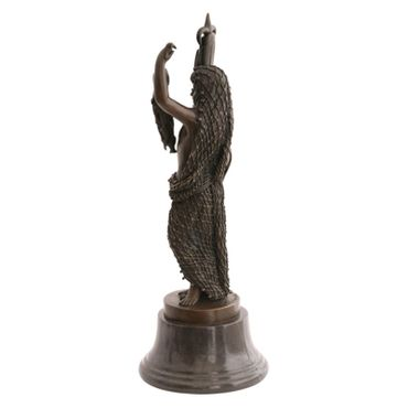 This figurine has been created in bronze in the shape of a small boy wearing a fishing net and holding up some fish in one hand with a harpoon with a rope in the other. – image 2