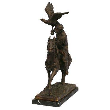 Air strike of a bird on a rider's shoulder, the rider sits upon a horse. This bronze sculpture is perfect for decorating your home or garden. – image 3