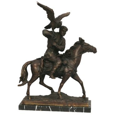 Air strike of a bird on a rider's shoulder, the rider sits upon a horse. This bronze sculpture is perfect for decorating your home or garden. – image 1