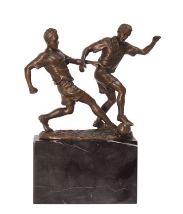 Bronze statue of two men playing football on marble