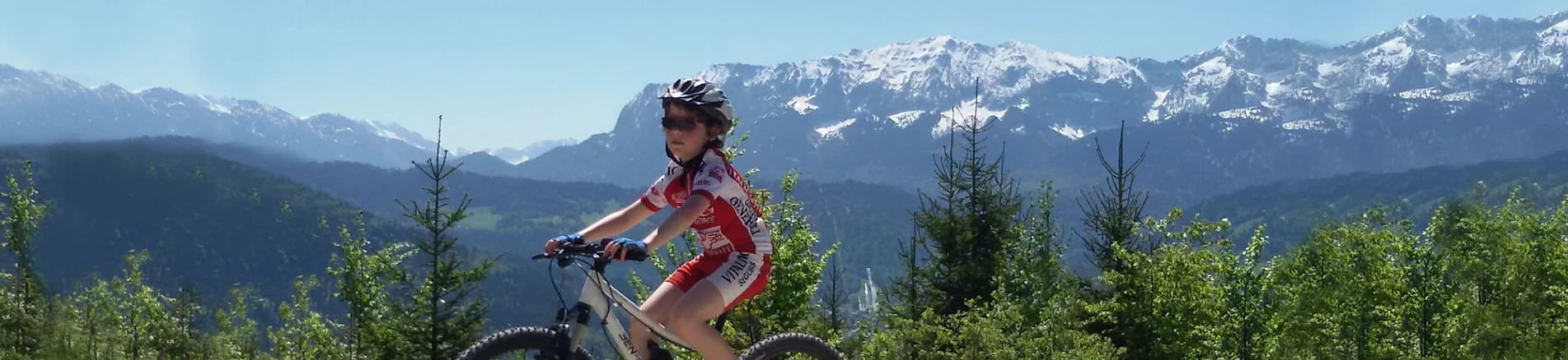Girl rides ben-e-bike in the Alps