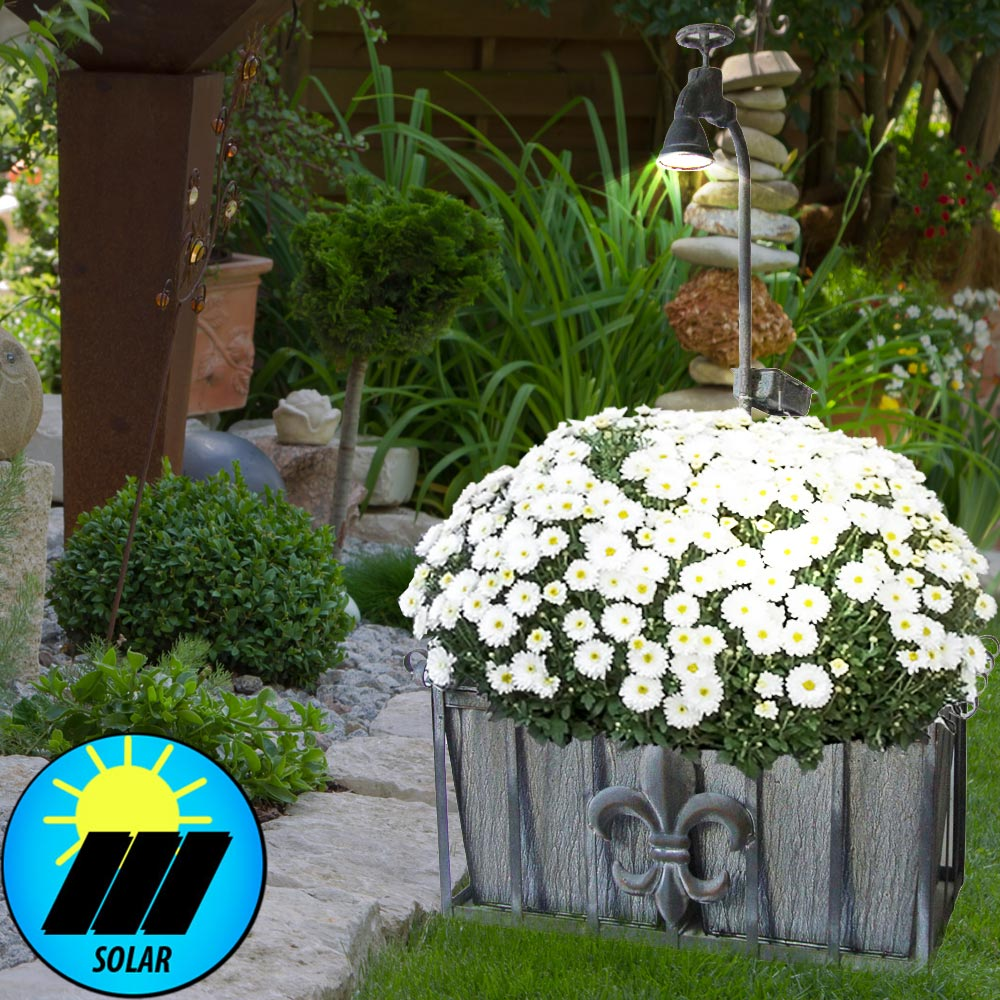 Planter with LED solar light in the decorative faucet Lamps ...