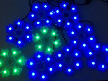 "LED-Silhouette ""Multi-Pix"", 9 Schneeflocken – Bild 1"