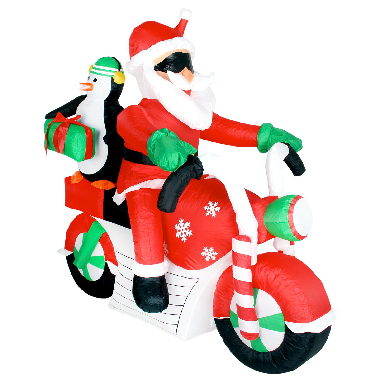 weihnachtsmann auf motorrad mit pinguin und geschenk. Black Bedroom Furniture Sets. Home Design Ideas
