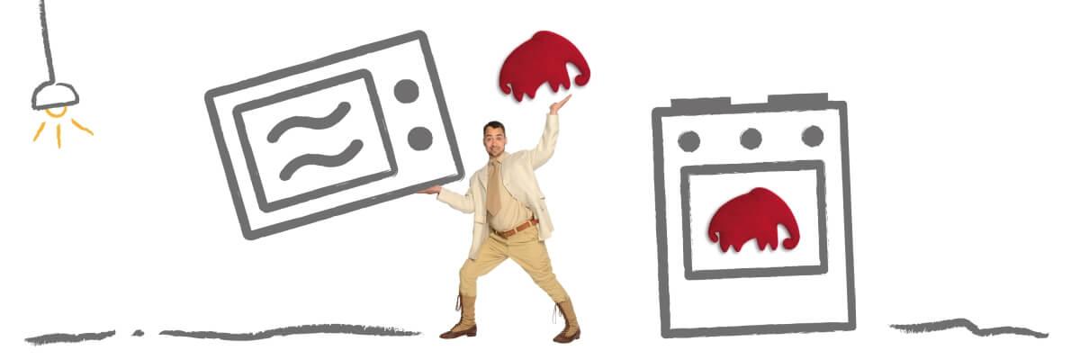 Mann balanciert mit den Händen eine Mikrowelle und einen Backofen