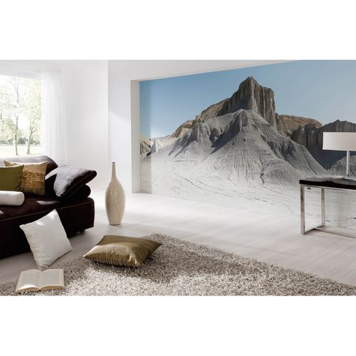 Fototapete Vlies Premium Berge Felsen Wüste grau blau