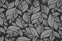 Jacquard Stoff Melbourne mit Blättern in grau auf schwarz 001