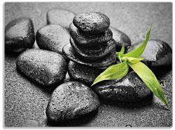 Glasunterlage Bambustrieb auf schwarzen Steinen, benetzt mit Wasser-Tropfen – Bild 1