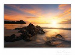 Herdabdeckplatte Sonne über dem Meer mit Felsenlandschaft