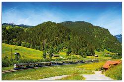 Herdabdeckplatte Eisenbahn in einer Sommerlandschaft in der Schweiz – Bild 1
