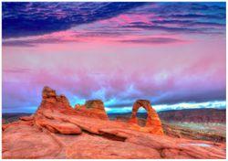 Wandbild Farbenfrohes Naturdenkmal - Steinbogen im Nationalpark Arches – Bild 1