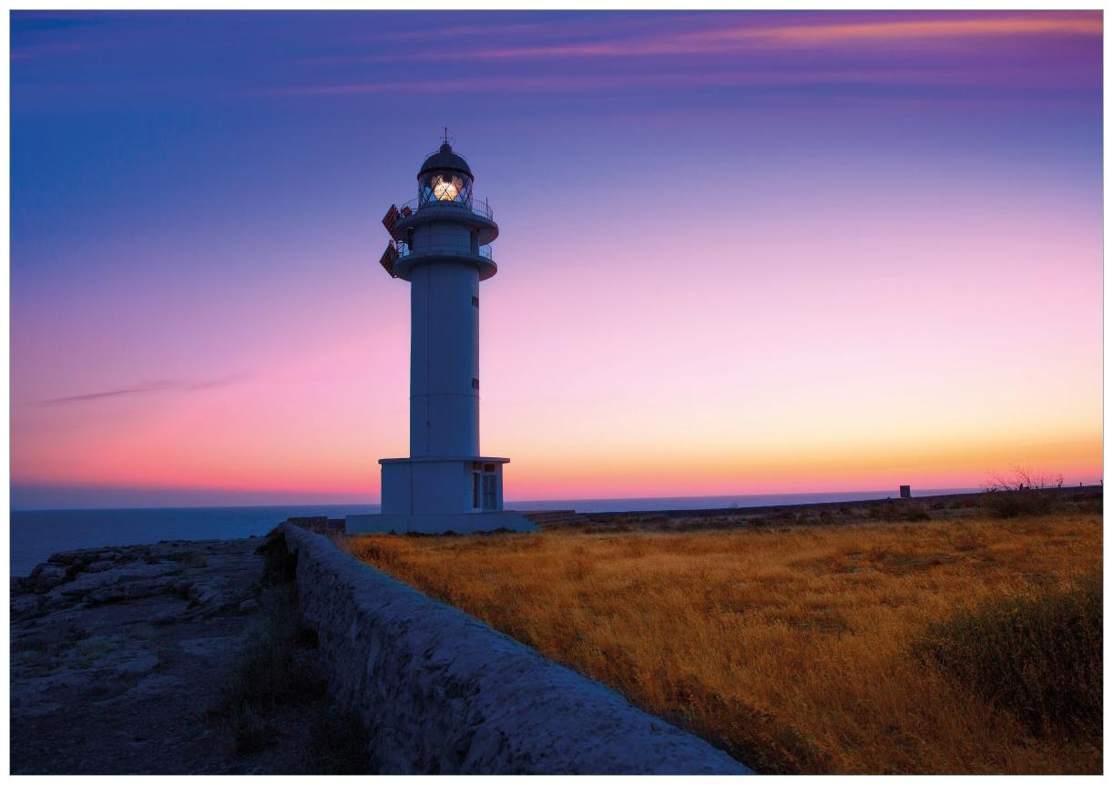 Wandbild Leuchtturm am Abend auf den Balearen – Malerischer Himmel – Bild 1