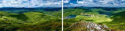 Glasbild Wildromantische Berglandschaft mit See