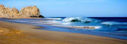 Glasbild Wellen am Sandstrand