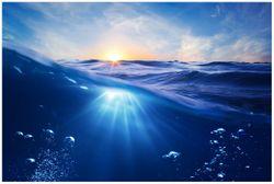 Vliestapete Wellen im Meer bei Sonnenuntergang – Bild 1
