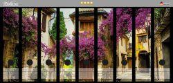 Ordnerrücken Sticker Malerische Stadt in der Provence mit bunten Blumen