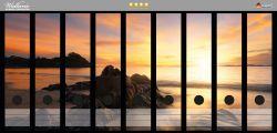 Ordnerrücken Sticker Sonne über dem Meer mit Felsenlandschaft