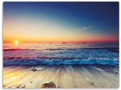 Glasunterlage Sonnenuntergang am Meer mit Wellen am Strand – Bild 1
