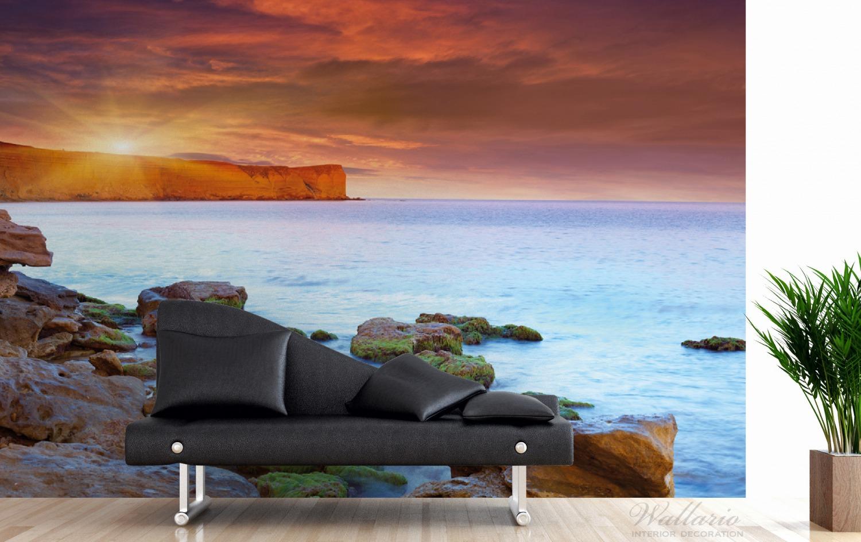 Vliestapete Sonnenaufgang am Meer mit Landzunge und Felsen im Wasser – Bild 3