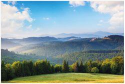 Vliestapete Berglandschaft im Gebirge unter blauem Himmel – Bild 1