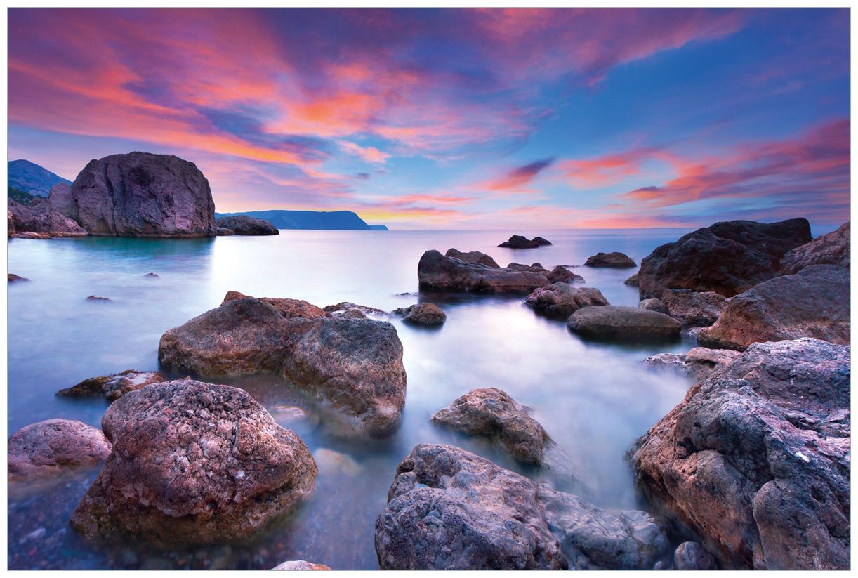 Vliestapete Seelandschaft in blau und rot mit großen Felsen – Bild 1