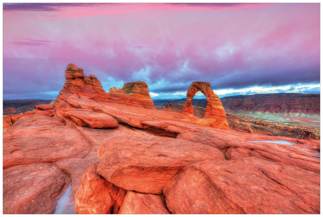 Vliestapete Farbenfrohes Naturdenkmal - Steinbogen im Nationalpark Arches – Bild 1
