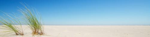 Küchenrückwand Sandstrand unter blauem Himmel