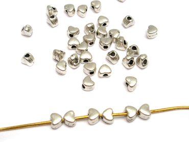 Metallperlen Tibet Spacer 3x3mm mini Herzen Silber, 30 Stück #A20071