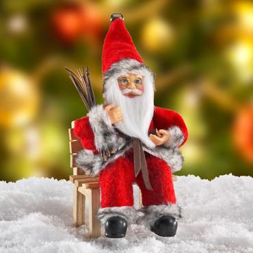 Weihnachtsmann auf Bank