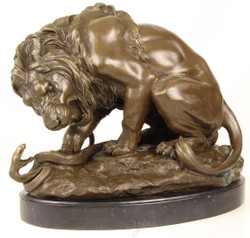 Casa Padrino Luxury Bronze Sculpture Lion with Snake on Marble Base Bronze / Gold / Black 41 x H. 35 cm - Luxury Bronze Figure