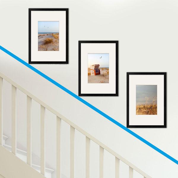 Treppenhaus gestalten mit drei Bilderrahmen