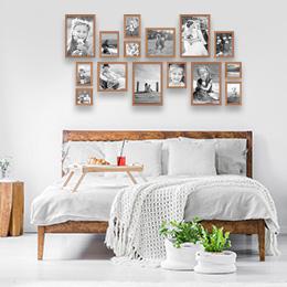 Wandgestaltung im Schlafzimmer mit Bilderrahmen