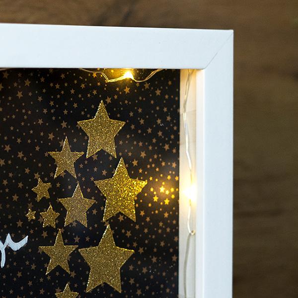 Weihnachtsdeko beleuchteter Bilderrahmen Ecke des Bilderrahmen