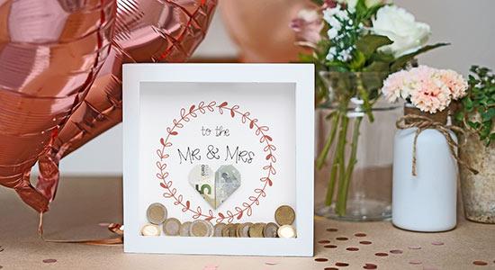 Hochzeitsgeschenk Geld in einer Bilderrahmen-Spardose