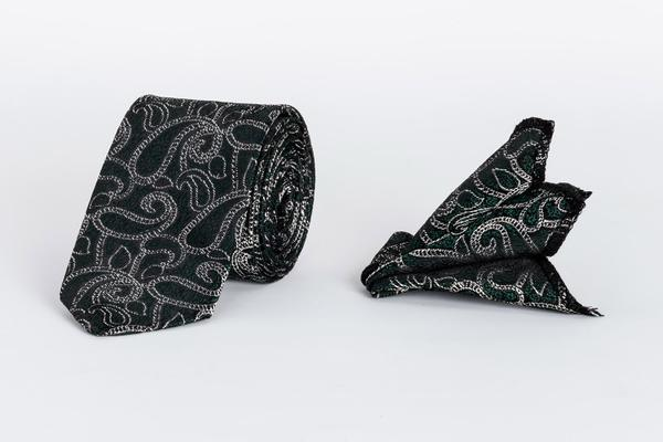 Green kids tie with paisley pattern