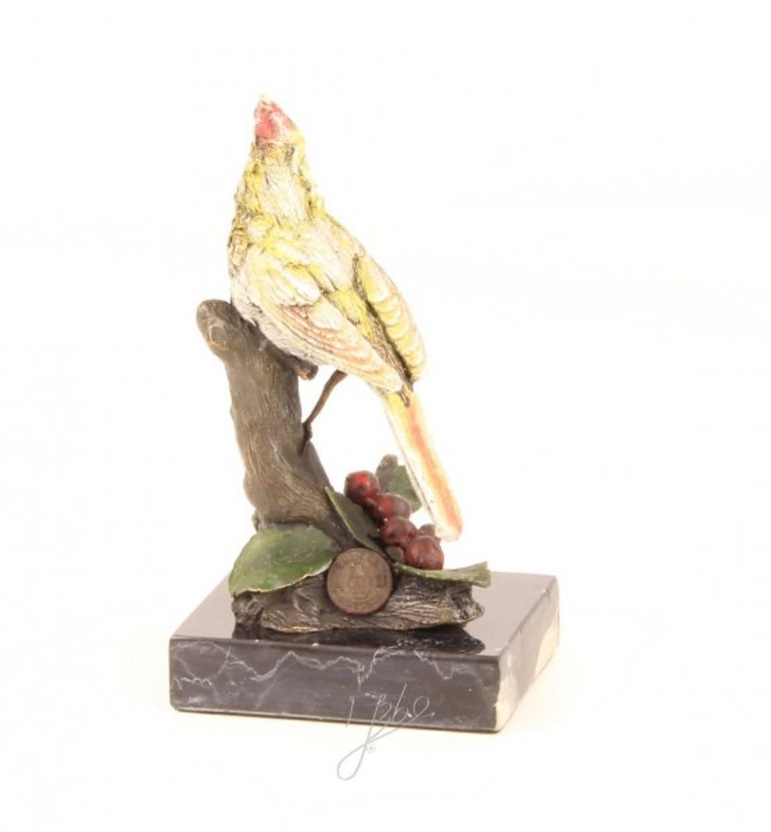 Vogel auf Baumstamm als bunte Bronze Statue kaufen. Tolle Deko Figur.