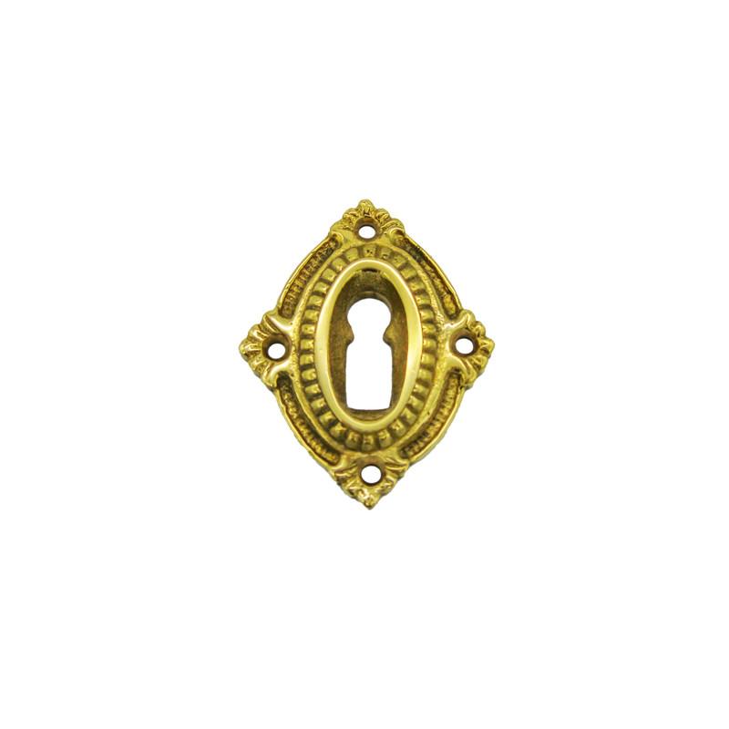 Design Zimmertüren Messing BB Rosette in ovaler Form mit feiner Riffelung und Verzierungen im antiken Design.