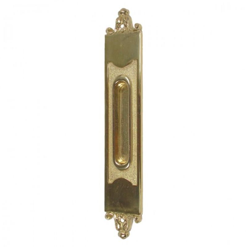 Schiebetüren Griff als glänzender Messing Beschlag für eine Holztür.
