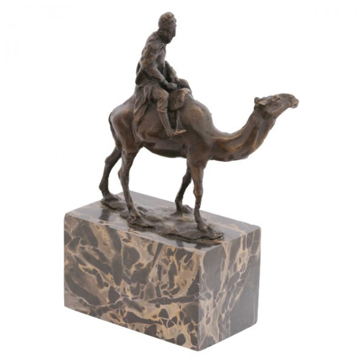Orientalische Deko aus Bronze , die einen Beduinen Reiter auf Dromedar zeigt.