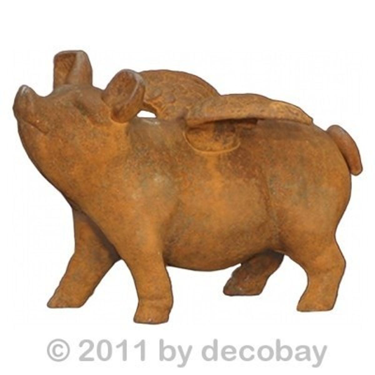 Sparschwein rostig als Glücksbringer aus Gusseisen. Wunderbar antik gestaltet.